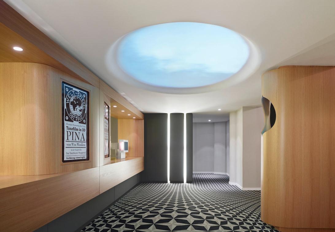 4D电影院装修设计中要注意放映机房的位置。放映机房由放映、倒片、配电等各部分组成,合于一室。机房内宜增设维修、休息及专用厕所。 多厅电影院各观众厅的放映机房应集中设置为中央放映机房。观众厅较多时,中央放映机房每层不宜多于两处,并应有走道相通,通道宽度不应小于1.